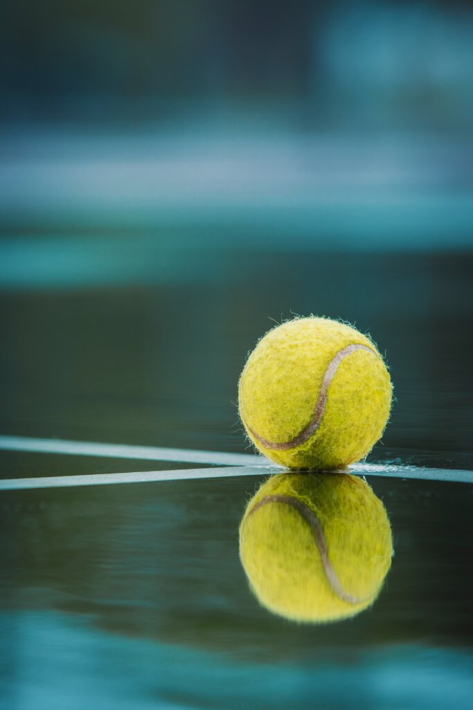 Tennis Ball on wet court